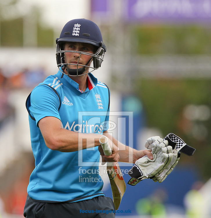 Chris Woakes of England walks off after getting out during the Royal London One Day Series match at Edgbaston, Birmingham<br /> Picture by Tom Smith/Focus Images Ltd 07545141164<br /> 02/09/2014