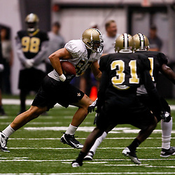 July 31, 2010; Metairie, LA, USA; New Orleans Saints tight end Jimmy Graham (80) runs after a catch during a training camp practice at the New Orleans Saints indoor practice facility. Mandatory Credit: Derick E. Hingle