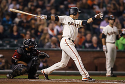 SAN FRANCISCO, CA - APRIL 20: Joe Panik #12 of the San Francisco Giants hits a double against the Arizona Diamondbacks during the third inning at AT&T Park on April 20, 2016 in San Francisco, California.  (Photo by Jason O. Watson/Getty Images) *** Local Caption *** Joe Panik