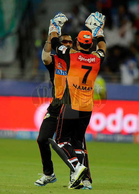 Naman Ohja of the Sunrisers Hyderabad celebrates the wicket of Aditya Tare of the Mumbai Indians  during match 20 of the Pepsi Indian Premier League Season 2014 between the Mumbai Indians and the Sunrisers Hyderabad held at the Dubai International Stadium, Dubai, United Arab Emirates on the 30th April 2014<br /> <br /> Photo by Pal Pillia / IPL / SPORTZPICS