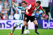 Onderwerp/Subject: Feyenoord - Willem II - Eredivisie<br /> Reklame:  <br /> Club/Team/Country: Feyenoord - Willem II<br /> Seizoen/Season: 2010/2011<br /> FOTO/PHOTO: Feyenoord's Stefan DE VRIJ (R) in duel with Willem II's Lars HUTTEN (L). (Photo by PICS UNITED)<br /> <br /> Trefwoorden/Keywords:  <br /> #04 $94 &plusmn;1279295324043<br /> Photo- &amp; Copyrights &copy; PICS UNITED <br /> P.O. Box 7164 - 5605 BE  EINDHOVEN (THE NETHERLANDS) <br /> Phone +31 (0)40 296 28 00 <br /> Fax +31 (0) 40 248 47 43 <br /> http://www.pics-united.com <br /> e-mail : sales@pics-united.com (If you would like to raise any issues regarding any aspects of products / service of PICS UNITED) or <br /> e-mail : sales@pics-united.com   <br /> <br /> ATTENTIE: <br /> Publicatie ook bij aanbieding door derden is slechts toegestaan na verkregen toestemming van Pics United. <br /> VOLLEDIGE NAAMSVERMELDING IS VERPLICHT! (&copy; PICS UNITED/Naam Fotograaf, zie veld 4 van de bestandsinfo 'credits') <br /> ATTENTION:  <br /> &copy; Pics United. Reproduction/publication of this photo by any parties is only permitted after authorisation is sought and obtained from  PICS UNITED- THE NETHERLANDS