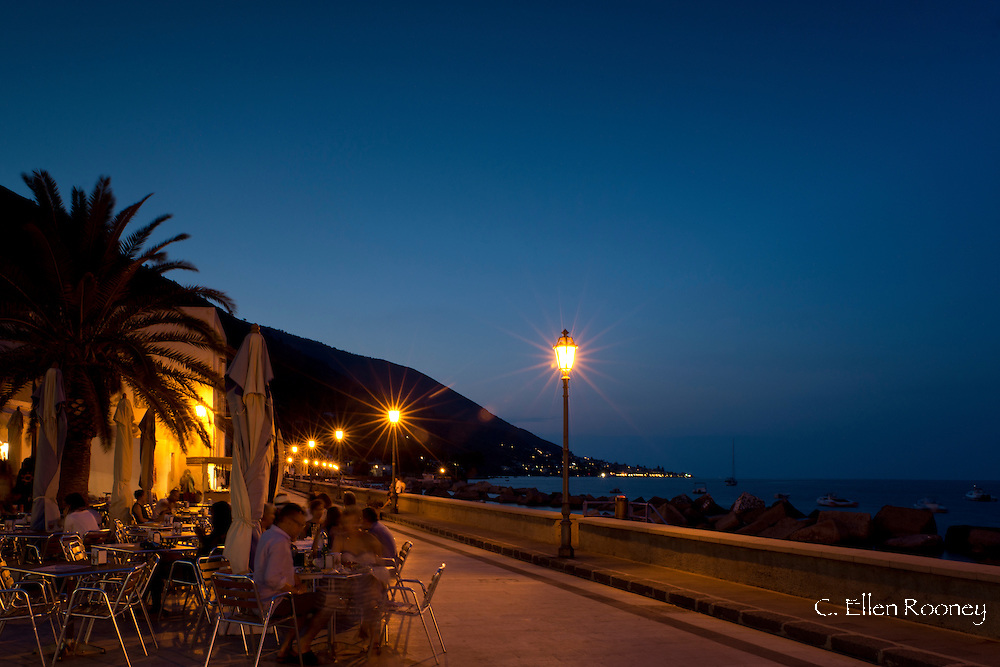 Restaurants at dusk along the seafront in Lingue, Salina, The Aeolian Islands, Sicily, Italy