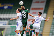 Darius Henderson (34) of Mansfield Town, Oscar Threlkeld (18) of Plymouth Argyle and CJ Hamilton (22) of Mansfield Town battle for possession during the EFL Sky Bet League 2 match between Plymouth Argyle and Mansfield Town at Home Park, Plymouth, England on 20 August 2016. Photo by Graham Hunt.