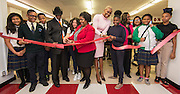 Students join Dr. James Douglas, Renita Perry, Trustee Jolanda Jones and Grenita Lathan for a ribbon cutting during a library dedication at Attucks Middle School, January 18, 2017.