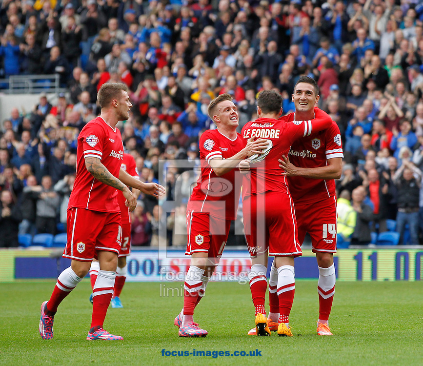 Federico Macheda (R) celebrates the first goal for Cardiff City against Nottingham Forest during the Sky Bet Championship match at the Cardiff City Stadium, Cardiff<br /> Picture by Mike  Griffiths/Focus Images Ltd +44 7766 223933<br /> 18/10/2014