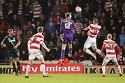 Doncaster Rovers goalkeeper Thorsten Stuckmann heads the ball goal wards from a last minute corner during the The FA Cup third round match between Doncaster Rovers and Stoke City at the Keepmoat Stadium, Doncaster, England on 9 January 2016. Photo by Simon Davies.