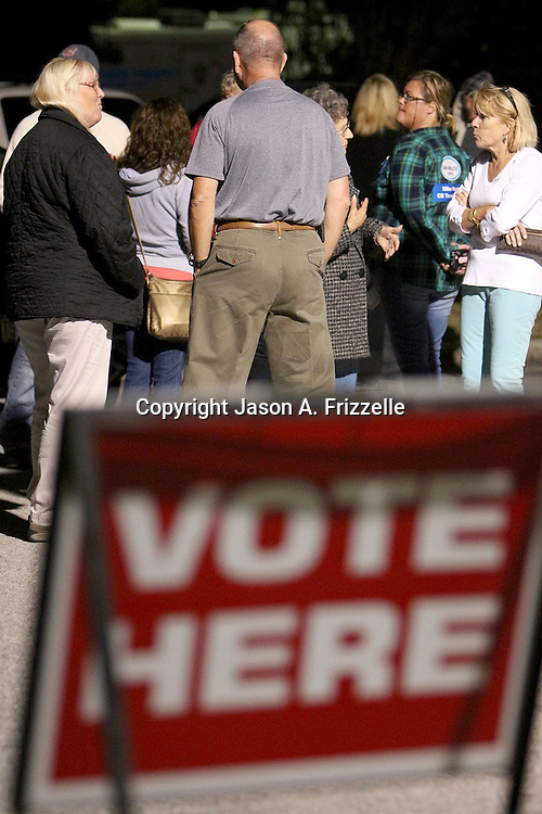 Voters wait outside the Carolina Beach Recreation Center. (Jason A. Frizzelle)