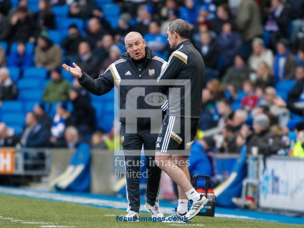 Brentford Manager Mark Warburton and assistant David Weir during the Sky Bet Championship match between Brighton and Hove Albion and Brentford at the American Express Community Stadium, Brighton and Hove<br /> Picture by Mark D Fuller/Focus Images Ltd +44 7774 216216<br /> 17/01/2015