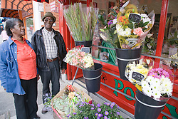 Older couple looking at flowers at a florist shop,