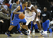 CHARLOTTE - APRIL 24:  Guard Jameer Nelson #14 of the Orlando Magic dribbles witht the ball while guard Raymond Felton #20 of the Charlotte Bobcats defends him during Game Three of the Eastern Conference Quarterfinals during the 2010 NBA Playoffs at Time Warner Cable Arena on April 24, 2010 in Charlotte, North Carolina. NOTE TO USER: User expressly acknowledges and agrees that, by downloading and/or using this photograph, user is consenting to the terms and conditions of the Getty Images License Agreement.  The Magic beat the Bobcats 90-86.  (Photo by Mike Zarrilli/Getty Images) *** Local Caption *** Jameer Nelson; Raymond Felton