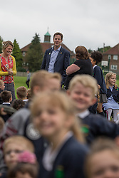 © Licensed to London News Pictures . 03/07/2014 . Leeds , UK . The Deputy Prime Minister , NICK CLEGG MP , at Ireland Wood Primary School in Leeds today (Thursday 3rd July 2014) . The Liberal Democrat leader and MP for Sheffield Hallam watches a Grand Depart school event with children taking part in cycling time trials and singing the the Tour de France anthem . Photo credit : Joel Goodman/LNP