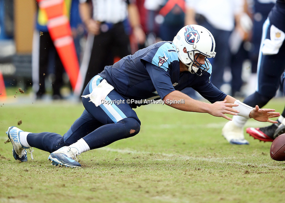 Tennessee Titans quarterback Zach Mettenberger (7) recovers his own fumble late in the fourth quarter during the 2015 week 7 regular season NFL football game against the Atlanta Falcons on Sunday, Oct. 25, 2015 in Nashville, Tenn. The Falcons won the game 10-7. (©Paul Anthony Spinelli)