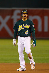 June 28, 2011; Oakland, CA, USA; Oakland Athletics center fielder Coco Crisp (4) leads off second base against the Florida Marlins during the fourth inning at the O.co Coliseum.  Oakland defeated Florida 1-0.