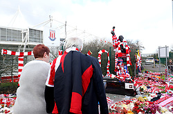 A general view of fans as they observe the memorial surrounding the Gordon Banks statue outside the bet365 Stadium, Stoke.