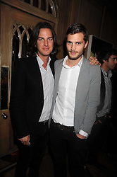 Left to right, ? and JAMIE DORNAN at a party to celebrate the launch of Hollywood Domino - a brand new board game, held at Mosimann's 11b West Halkin Street, London on 7th November 2008.  The evening was in aid of Charlize Theron's Africa Outreach Project.