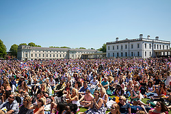 © Licensed to London News Pictures. 19/05/2018. London, UK. Thousands of well-wishers watch the Royal Wedding at an outdoor screening at the National Maritime Museum in Greenwich. Prince Harry is getting married to Meghan Markle today in Windsor. Photo credit: Rob Pinney/LNP