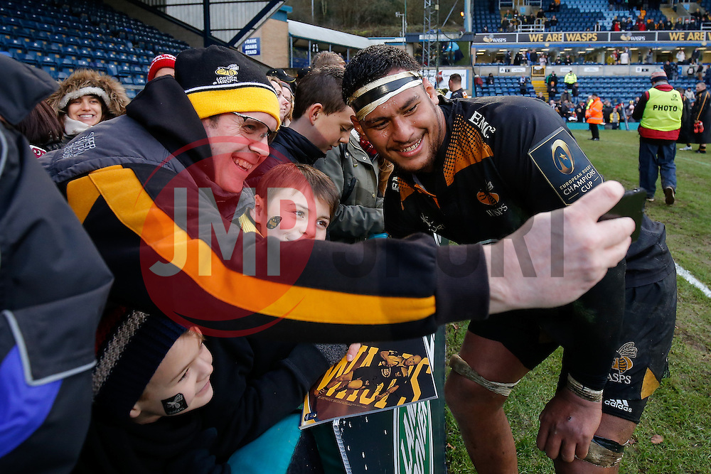 Wasps Number 8 Nathan Hughes takes a selfie with fans after his sides last match at Adams Park. Wasps next home game will be at their new home in Coventry, the Ricoh Arena - Photo mandatory by-line: Rogan Thomson/JMP - 07966 386802 - 14/12/2014 - SPORT - RUGBY UNION - High Wycombe, England - Adams Park Stadium - Wasps v Castres Olympique - European Rugby Champions Cup Pool 2.