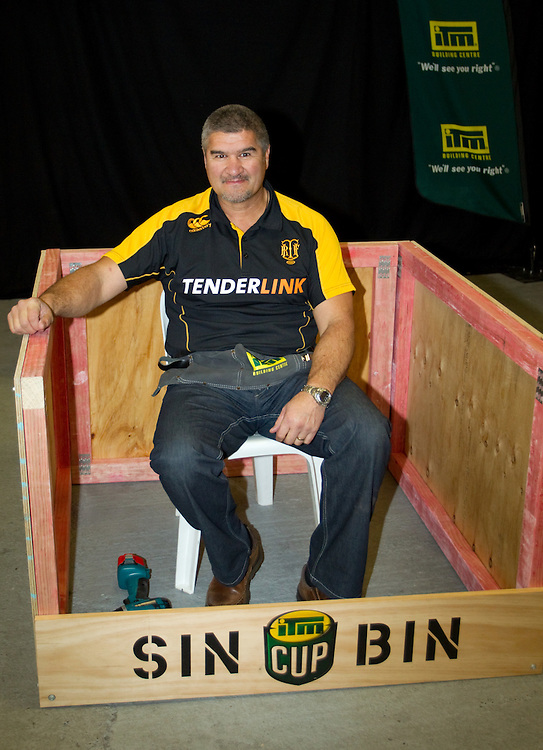 Taranaki Head Coach Colin Cooper sits in his constructed sin bin after taking part in the coach challenge at the 2012 ITM Cup Rugby Season Launch, Shed 10, Auckland, New Zealand, Monday, August 06, 2012. Credit:SNPA / David Rowland