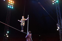 © Licensed to London News Pictures. 22/04/2015. Guildford, UK. Kelly-Marie Blundell is guided through the process by comedy artist Vladimir Georgieski. Liberal Democrat Kelly-Marie Blundell walks the high wire at Moscow State Circus in Guildford. Photo credit : Stephen Simpson/LNP
