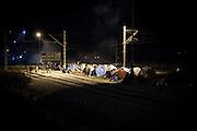 02 December 2015, Greece, Idomeni - Migrants and refugees wait to cross the Greek-Macedonian border near the village of Idomeni, Greece. Tents of migrants refugees on the rail station near the border Greece-Macedonia.