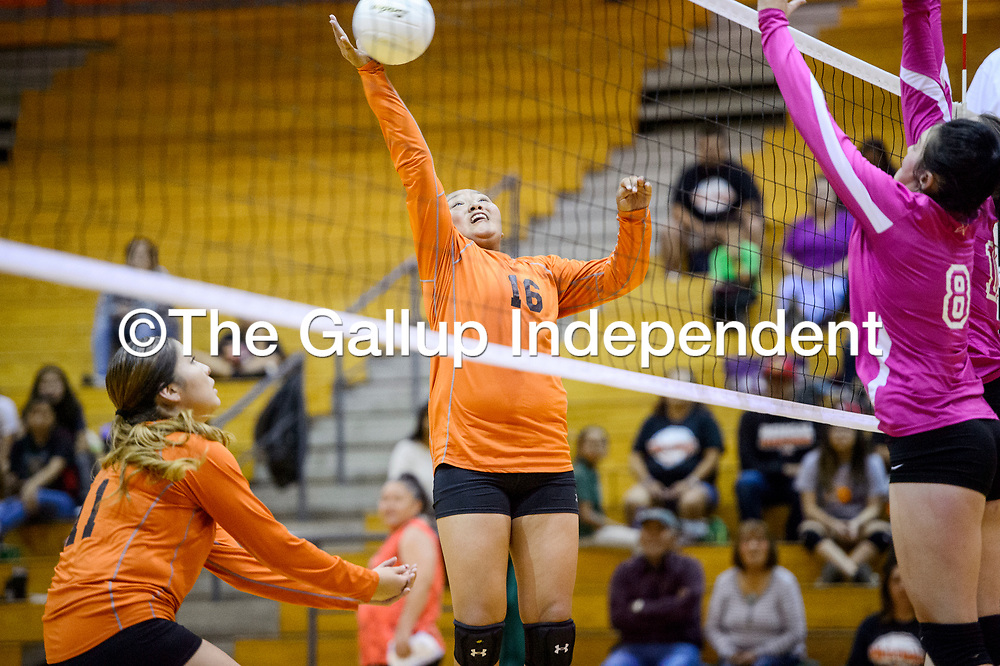Gallup Bengal Hailey Long (16) spikes the ball over to the Aztec Tigers Thursday at Gallup High School.