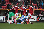 Coventry City defender Aaron Martin and Swindon Town defender Jordan Turnbull and Swindon Town midfielder Yaser Kasim during the Sky Bet League 1 match between Swindon Town and Coventry City at the County Ground, Swindon, England on 24 October 2015. Photo by Jemma Phillips.