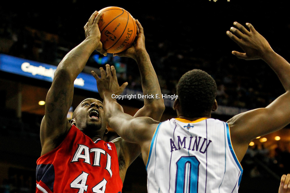 January 29, 2012; New Orleans, LA, USA; Atlanta Hawks forward Ivan Johnson (44) shoots over New Orleans Hornets small forward Al-Farouq Aminu (0) during the second half of a game at the New Orleans Arena. The Hawks defeated the Hornets 94-72.  Mandatory Credit: Derick E. Hingle-US PRESSWIRE