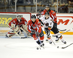 Eric Wellwood of the Windsor Spitfires chases the puck in Game 4 of the 2010 MasterCard Memorial Cup in Brandon, MB on Monday May 17. Photo by Aaron Bell/CHL Images