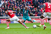 Swansea City forward Andre Ayew (22) shoots during the EFL Sky Bet Championship match between Barnsley and Swansea City at Oakwell, Barnsley, England on 19 October 2019.