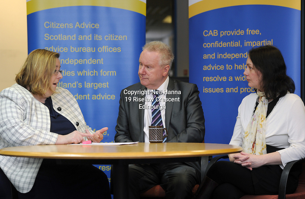 Extra cash to help poverty-stricken Scots.<br /> Citizens Advice Scotland (CAS) will receive almost &pound;1.5 million extra next year to alleviate Westminster&rsquo;s welfare reform changes, Social Justice Secretary Alex Neil confirmed today. The Scottish Government funding comes on top of &pound;2.5 million it has allocated to support CAS&rsquo;s Welfare Reform Mitigation Fund between 2013-2015.<br /> <br /> The fund was established to offer a range of services for local Bureaux across Scotland, including additional resources to support the move to online claims. The additional &pound;1.5 million will allow CAB to employ more staff, operate longer opening ho provide more training for advisers and recruit more volunteers across the 200 CAB service points in operation across Scotland.<br /> <br /> According to CAS, in the first year over 17,500 people were helped with over 55,000 issues. The service now sees an additional 6,000 clients every three months thanks to Scottish Government funding. The top three areas which clients have requested help with have been benefits, debt and tax issues. However, CAB advisers are able to provide support on a wide range of other issues.<br /> <br /> The Scottish Government has set aside &pound;104 million in next year&rsquo;s budget to tackle poverty and inequalities including &pound;33 million to the Scottish Welfare Fund.<br /> <br />  Mr Neil was meet by Citizens Advice Scotland CEO, Margaret Lynch and Citizens Advice Edinburgh CEO, Moira Tasker as well as CAB volunteers and staff on his visit to Leith Citizens Advice Bureaux, 12 Bernard Street, Edinburgh.<br /> <br /> <br /> <br /> <br />  Neil Hanna Photography<br /> www.neilhannaphotography.co.uk<br /> 07702 246823