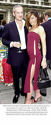 MISS TARA PALMER-TOMKINSON and MR ANTON BILTON, at a party in London on 18th June 2001.OPM 80