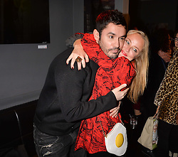 Jean-Bernard Fernandez Versini and Erica Bergsmeds at an exhibition of photographs by Erica Bergsmeds held at The Den, 100 Wardour Street, London England. 19 January 2017.