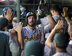 May 12, 2017 - Arlington, TX, USA - Oakland Athletics' Matt Joyce (23) gets high fives in the dugout after a solo home run in the fifth inning against the Texas Rangers on Friday, May 12, 2017 at Globe Life Park in Arlington, Texas. (Credit Image: © Richard W. Rodriguez/TNS via ZUMA Wire)