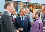 © Licensed to London News Pictures. 29/08/2014. Clacton-on-Sea, UK Douglas Carswell (L) and Nigel Farage (R), Leader of the UK Independence Party, UKIP, meet local people on a walk about in Clacton-on-Sea today 29th August 2014. Tory Douglas Carswell  defected to UKIP and quit as MP for Clacton, saying he will contest the subsequent by-election for Nigel Farage's party.. Photo credit : Stephen Simpson/LNP