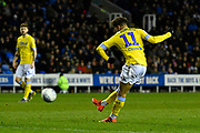 Tyler Roberts (11) of Leeds United shoots at goal during the EFL Sky Bet Championship match between Reading and Leeds United at the Madejski Stadium, Reading, England on 12 March 2019.
