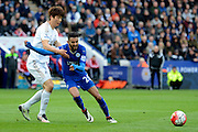 Leicester City midfielder Riyad Mahrez plays the ball away from Swansea City midfielder Ki Sung-Yueng during the Barclays Premier League match between Leicester City and Swansea City at the King Power Stadium, Leicester, England on 24 April 2016. Photo by Alan Franklin.