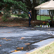 Charlotte, NC- September 22, 2016: A young man comes to pay his respects at the makeshift memorial where Keith Scott was killed from a police involved shooting in the parking lot of his apartment complex off Old Concord Road. CREDIT: LOGAN R. CYRUS FOR THE NEW YORK TIMES