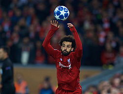 LIVERPOOL, ENGLAND - Tuesday, December 11, 2018: Liverpool's Mohamed Salah takes a throw-in during the UEFA Champions League Group C match between Liverpool FC and SSC Napoli at Anfield. (Pic by David Rawcliffe/Propaganda)