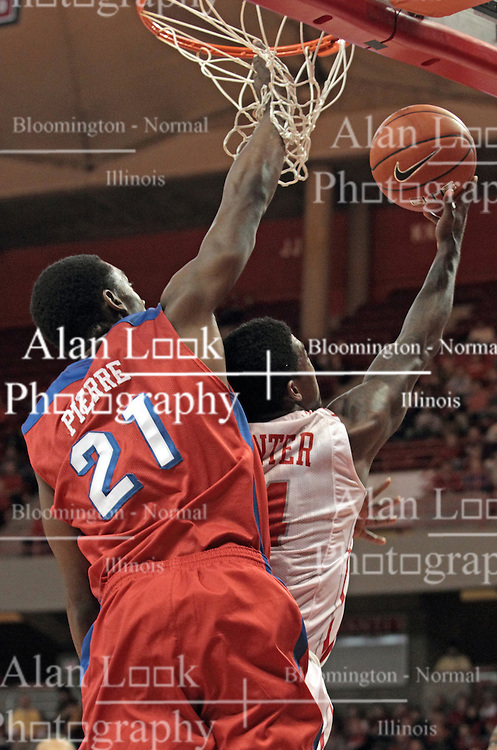 07 December 2013: Dyshawn Pierre gets his a handful of net as he tries to block a reverse by Bobby Hunter during an NCAA mens basketball game. The Illinois State Redbirds beat the 25th ranked Dayton Flyers 81-75 in Redbird Arena, Normal IL