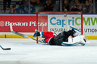 KELOWNA, BC - OCTOBER 2:  Roman Basran #30 of the Kelowna Rockets dives back in front of the net and makes a first period save against the Tri-City Americans at Prospera Place on October 2, 2019 in Kelowna, Canada. (Photo by Marissa Baecker/Shoot the Breeze)
