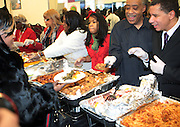 25 December 2009- Harlem, NY-l to r: Rev. Al Sharpton and Governor David Patterson serve food to the needy at Rev. Al Sharpton & The National Action Network's Annual Christmas Dinner and Toy Giveaway held at The National Action Network Headquarters in Harlem, USA on Decemeber 25, 2009 in New York City.