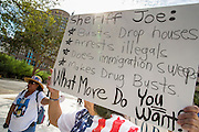 "19 JULY 2012 - PHOENIX, AZ:  MARTHA PAYAN (right under sign) speaks in support of Maricopa County Sheriff Joe Arpaio at the US Courthouse on the first day of a class action lawsuit, Melendres v. Arpaio in Phoenix Thursday. The suit, brought by the ACLU and MALDEF in federal court against Maricopa County Sheriff Joe Arpaio, alleges a wide spread pattern of racial profiling during Arpaio's ""crime suppression sweeps"" that targeted undocumented immigrants. U.S. District Judge Murray Snow granted the case class action status opening it up to all Latinos stopped by Maricopa County Sheriff's Office deputies during the crime sweeps. The case is being heard in Judge Snow's court.  PHOTO BY JACK KURTZ"