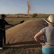 Couple harvesting wheat in Calzada de Valdunciel, Salamanca province. Spain . The WAY OF SAINT JAMES or CAMINO DE SANTIAGO following the Silver Way, between Seville and Astorga, SPAIN.Tradition says that the body and head of St. James, after his execution circa. 44 AD, was taken by boat from Jerusalem to Santiago de Compostela. The Cathedral built to keep the remains has long been regarded as important as Rome and Jerusalem in terms of Christian religious significance, a site worthy to be a pilgrimage destination for over a thousand years. In addition to people undertaking a religious pilgrimage, there are many travellers and hikers who nowadays walk the route for non-religious reasons: travel, sport, or simply the challenge of weeks of walking in a foreign land. In Spain there are many different paths to reach Santiago. The three main ones are the French, the Silver and the Coastal or Northern Way. The pilgrimage was named one of UNESCO's World Heritage Sites in 1993. When there is a Holy Compostellan Year (whenever July 25 falls on a Sunday; the next will be 2010) the Galician government's Xacobeo tourism campaign is unleashed once more. Last Compostellan year was 2004 and the number of pilgrims increased to almost 200.000 people.