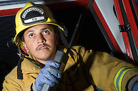 Firefighter using walkie talkie