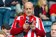 A Sunderland fan the EFL Sky Bet League 1 match between Rochdale and Sunderland at the Crown Oil Arena, Rochdale, England on 20 August 2019.