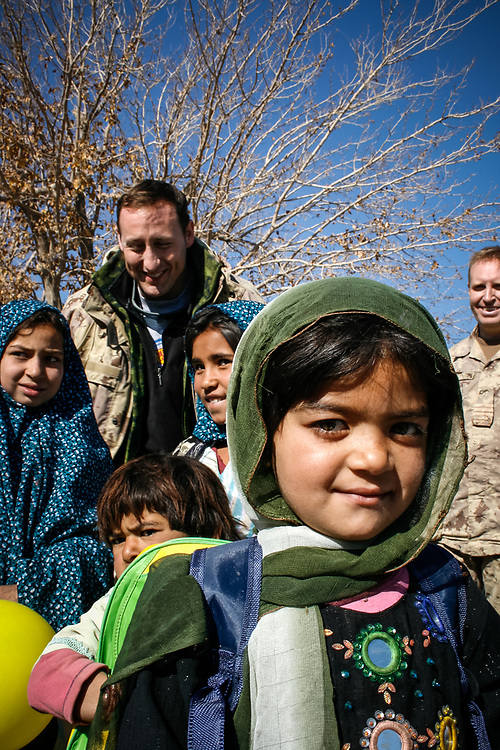 Peter MacKay, then minister of defense, visiting Camp Nathan Smith, Kandahar, Afghanistan, on Christmas day in 2007. Local kids had been invited in to receive gifts of school bags.