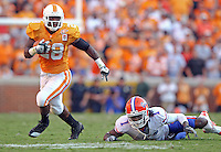 September 18,2010: Tennessee Volunteers running back Tauren Poole (28) runs after breaking a tackle from Florida Gators cornerback Janoris Jenkins (1) during the game at Neyland Stadium in Knoxville, Tennessee. The Gators won, 31-17.