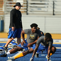 Tupelo High School Quarterback Coach John Keith walks the field during warm ups at Monday afternoons practice at Tupelo High School.