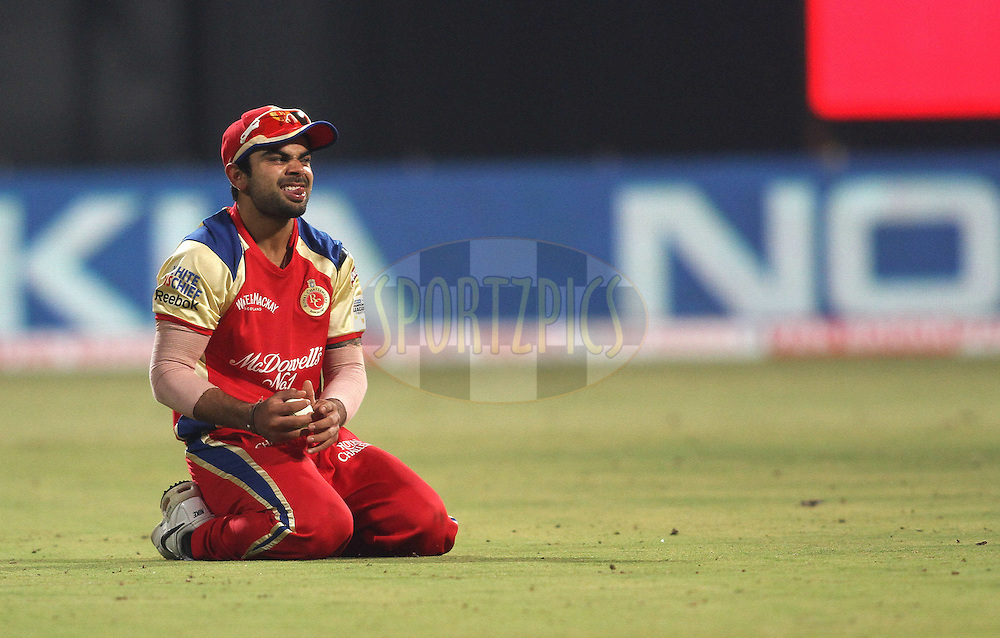 Virat Kohli of Royal Challengers Bangalore reacts after dropping a catch during match 1 of the NOKIA Champions League T20 ( CLT20 )between the Royal Challengers Bangalore and the Warriors held at the  M.Chinnaswamy Stadium in Bangalore , Karnataka, India on the 23rd September 2011..Photo by Shaun Roy/BCCI/SPORTZPICS