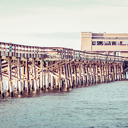 Newport Beach California Pier Vintage Panorama Picture. Newport Pier is in Newport Beach, Orange County, Southern California. Panoramic photo ratio is 1:3 and has a retro vintage 1960s tone.